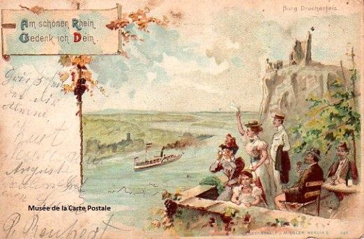 Carte postale ancienne représentant des promeneurs sur le bord du Rhin.