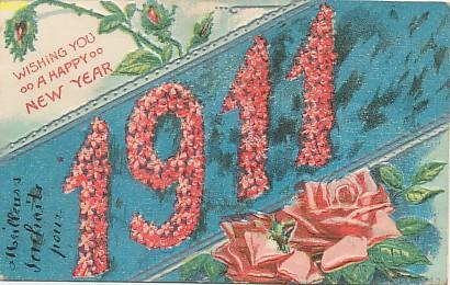 Symbole du temps qui passe, carte postale voeux de bonne année 1911, exposée au musée de la carte postale, à Antibes.