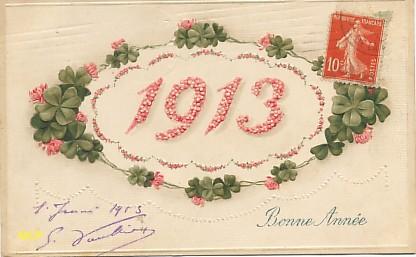 Symbole du temps qui passe, carte postale voeux de bonne année 1913, exposée au musée de la carte postale, à Antibes.