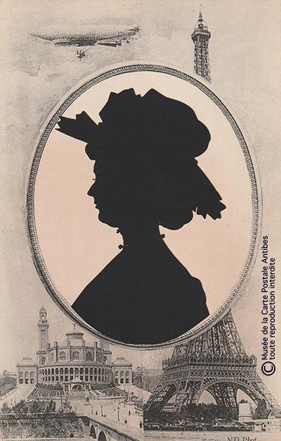 Carte postale ancienne représentant un dirigeable passant devant la Tour Eiffel.