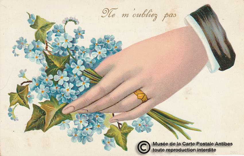 Carte postale main tendant un bouquet de fleurs.